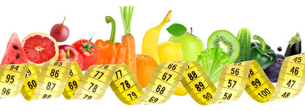 Fresh fruit and vegetable with measuring tape Stock Photo