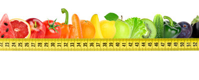 Fresh fruit and vegetable with measuring tape Royalty Free Stock Images
