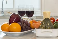 Fresh fruit, vegetable and red wine glass. Stock Photo