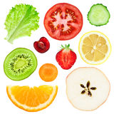 Fresh fruit and vegetable slices. Collection of fresh fruit and vegetable slices on white background Stock Images