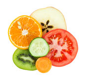 Fresh fruit and vegetable slices. Collection of fresh fruit and vegetable slices on white background. Orange, kiwi, apple, cucumber, tomato and carrot Royalty Free Stock Images