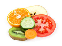 Fresh fruit and vegetable slices. Collection of fresh fruit and vegetable slices on white background. Orange, kiwi, apple, cucumber, tomato and carrot Stock Images