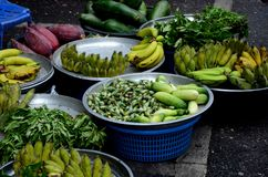 Fresh fruit and vegetables on display at roadside market Hatyai Thailand. Hatyai, Thailand - May 6, 2017: Metal trays containing fresh fruits and vegetables on Stock Images