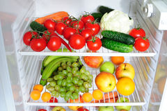 Fresh fruit and vegetables in the fridge Stock Images