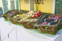 Fresh fruit and vegetables at market stall Stock Photo