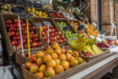 Fresh fruit and vegetables at market stall. Colorful fruits and vegetables at a market stall in London Stock Photo