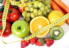 Fresh fruit and vegetables in measure tape Stock Photos