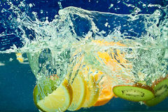 Fresh fruit in water Royalty Free Stock Photo