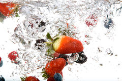 Fresh Fruit in Water Stock Images