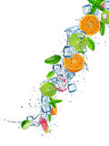 Fresh fruit in water splash over white Royalty Free Stock Photography