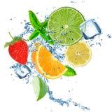 Fresh fruit in water splash over white Royalty Free Stock Photos