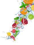 Fresh fruit in water splash over white Royalty Free Stock Image