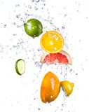 Fresh fruit with water splash Royalty Free Stock Photography