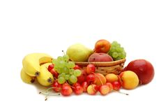 Fresh fruit in a wattled basket Stock Photos