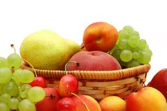 Fresh fruit in a wattled basket Royalty Free Stock Photos