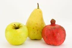 Fresh fruit on white backgroun. Fresh fruit: apple, pear, garnet isolated on white background Royalty Free Stock Photos