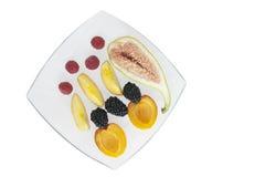 Fresh fruit on white plate royalty free stock photos