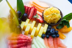 Fresh fruit on a white plate. Royalty Free Stock Image