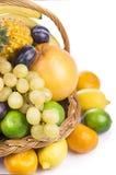 Fresh fruit in a wicker basket Stock Photos