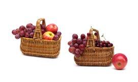 Fresh fruit in a wicker basket on a white background. Horizontal photo Royalty Free Stock Photos