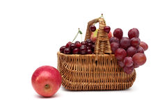Fresh fruit in a wicker basket on a white background. Horizontal photo Stock Images