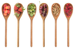 Fresh fruit in a wooden spoon Royalty Free Stock Photos