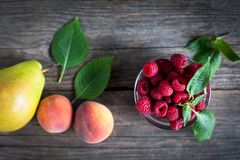 Fresh fruit on a wooden table royalty free stock images