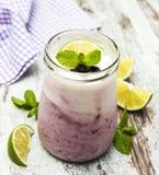 Fresh fruit yoghurt with blackberries Royalty Free Stock Photo