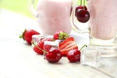 Fresh fruit yogurt with cherries and strawberries Royalty Free Stock Photo