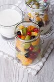 Fresh fruit with yogurt in a glass jar vertical top view Royalty Free Stock Image
