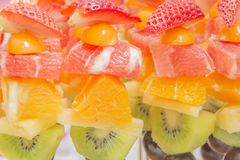 Fresh fruit zoom-kiwi,strawberries,orange,grapes royalty free stock photography