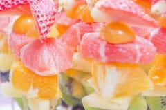 Fresh fruit zoom- strawberries, orange, kiwi stock image