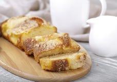 Fresh fruitcake, coffee and cream. Tasty fruitcake, fresh baking, coffee and cream Stock Image