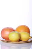 Fresh fruits. Fresh useful fruits on mirror table royalty free stock photo