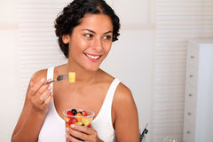 Fresh Fruits. Young woman making a break with fresh fruits stock image