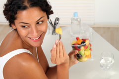 Fresh Fruits. Young woman making a break with fresh fruits royalty free stock photography