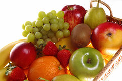 Fresh fruits. Assortment of fresh fruits in basket with white background royalty free stock photos