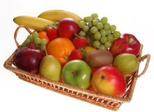 Fresh fruits. Assortment of fresh fruits in basket with white background Royalty Free Stock Image