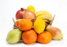 Fresh Fruits. Some fruits like orange, apple , plum and lemon over white background Royalty Free Stock Photo