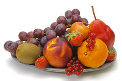 Fresh fruits. On plate over white background stock photos