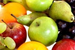 Fresh fruits. Fresh healthy colorful bio fruit full of vitamins, white background Royalty Free Stock Photography