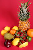 Fresh fruits. Many kind of fresh fruits on a red background Royalty Free Stock Photography