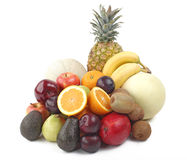 Fresh fruits. Assorted fresh fruit display - Isolated over the white background Stock Image