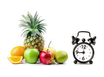 Fresh fruits and alarm clock Royalty Free Stock Photo