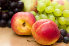Fresh fruits, apples, grapes and peaches Royalty Free Stock Photos