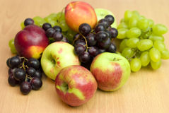 Fresh fruits, apples, grapes and peaches. On the table Stock Photos