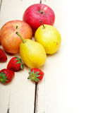 Fresh fruits apples pears and strawberrys Stock Image