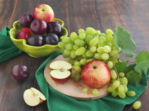 Fresh fruits: apples, plums, grapes Stock Photography