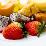 Fresh fruits. Fresh assorted and colorful cut fruits royalty free stock photo