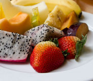 Fresh fruits. Fresh assorted and colorful cut fruits royalty free stock photos